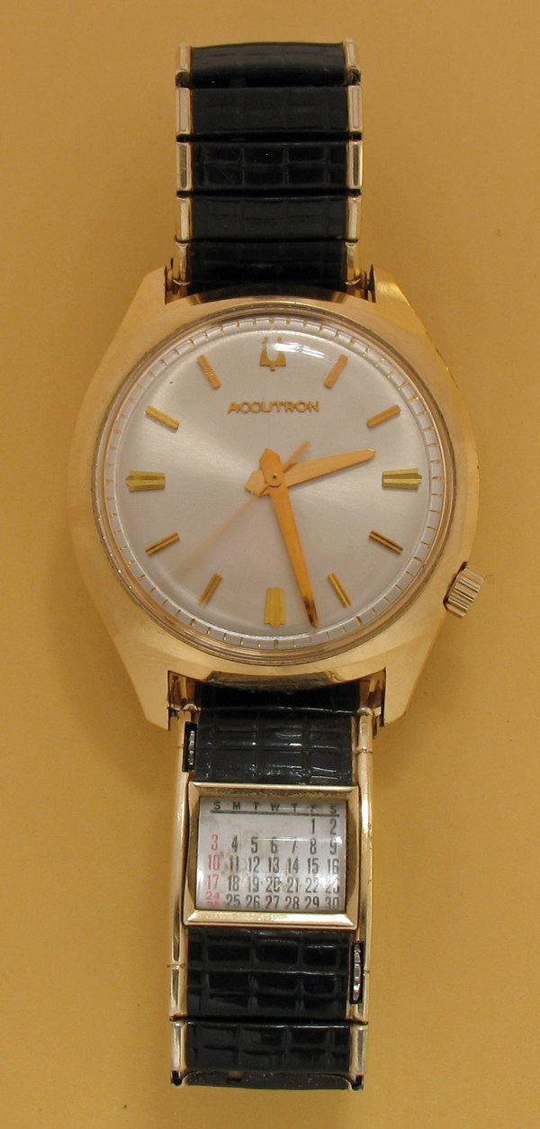 "An 'Accutron' tuning-fork watch, made by Bulova, USA, c.1970.  The one second exposure of the photgraph reveals the near sweep action of the seconds hand.  Note also the useful perpetual roller calendar in the strap (inscribed ""SPEIDEL PAT 2,689,450"")."