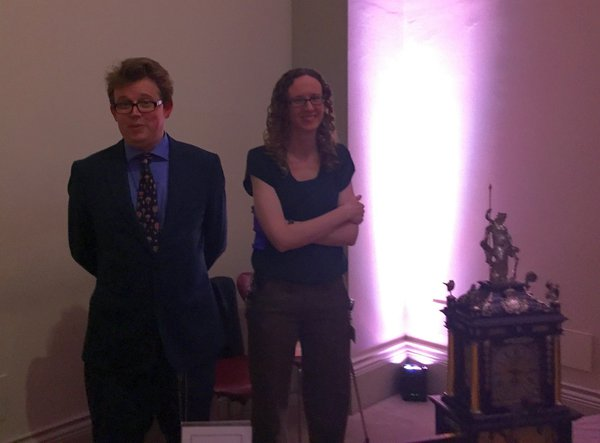 British Museum Curators Oliver Cooke and Laura Turner, standing vigilant by the clock.