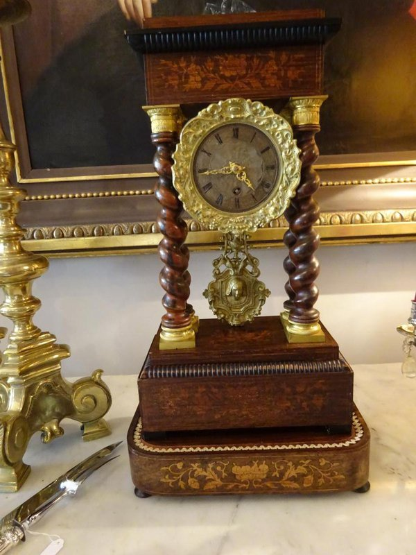The clock without its glass dome but with its gilt pendulum