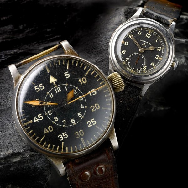 "Left: Alloy cased manual wind German observers watch by A. Lange & Sohne c. 1940s Right: Stainless steel manual wind military issue ""Greenlander"" wrist watch by Longines"
