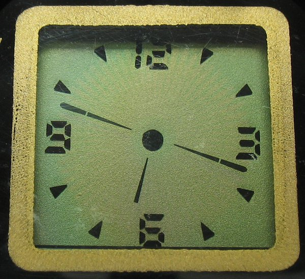 Close-up of the dial.  The time shown here is .  Despite the seconds and minute hands appearing identical in this still, the seconds are readily visible when reading the time