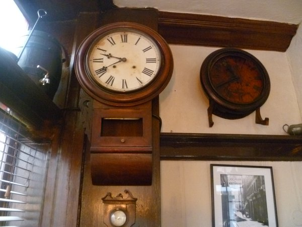 The clocks side by side — their hands frozen in time