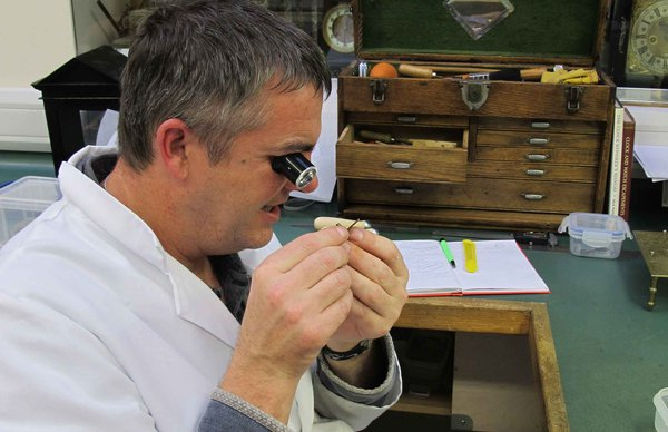 Quest-scholar-Tim-Hughes-inspects-a-minute-wheel-pinion-for-wear.