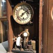 General arrangement view showing clock movement to the top and lighting control motor below